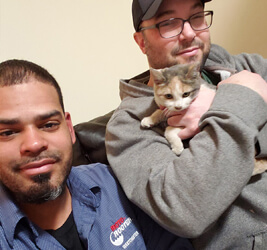 Moises Monsanto and rescued cat
