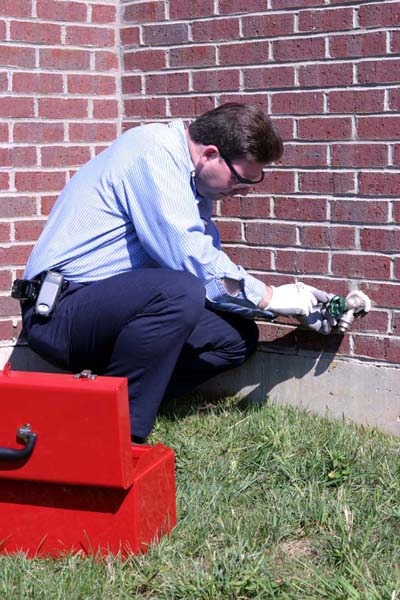 technician fixing an outdoor water line